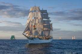 Main vessel, Norwegian Full Rigger Sorlandet. On the horizon, Alexander von Humboldt, Pelican of London and Asgard II