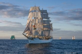 Main vessel, Norwegian Full Rigger Sorlandet. On the horizon, Alexander von Humboldt, Pelican of London and Asgard II