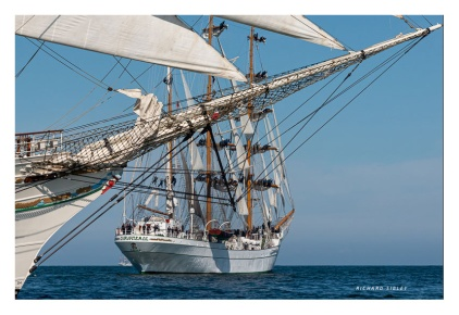 Dowsing sail onboard the Mexican barque Cuauhtemoc. Foreground vessel Shabab Oman
