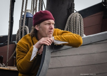 The Capitan waiting impatiently for the cargo to be loaded. The weather is changing and he wants to get underway