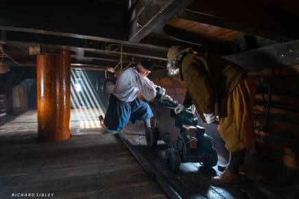 The sunlight streaming in catches the smoke below decks