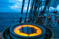 Heading south, the deck compass at night